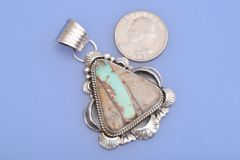 Medium-size Navajo Sterling pendant with ribbon (boulder) turquoise by Gilbert Tom