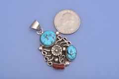 Dead-pawn Navajo pendant with Mediterranean coral and Sleeping Beauty turquoise.