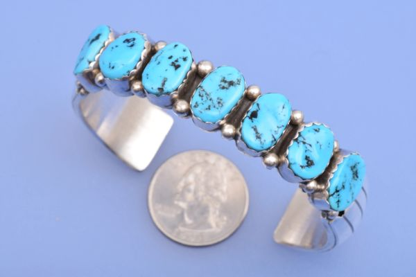 Dead-pawn Navajo heavy-silver Sterling cuff with seven Sleeping Beauty mine turquoise stones.