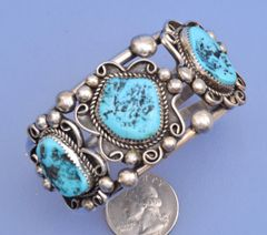 Dead-pawn Navajo Sterling cuff with three Sleeping Beauty turquoise stones.