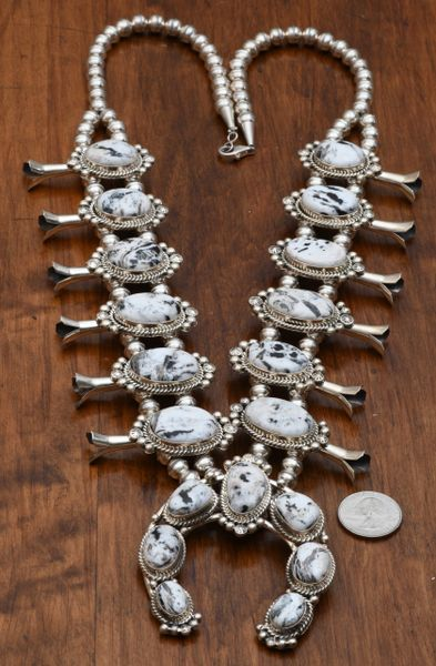 Sterling squash blossom with nineteen White Buffalo stones by Augustine Largo, Navajo. #0654