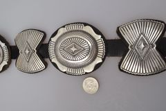 Navajo dead-pawn, thick-gauge, leather-backed sterling concho belt with alternating butterfly conchos.—SOLD!