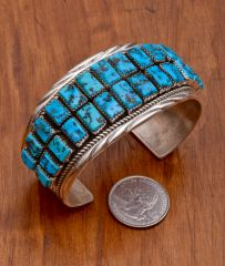 Dead-pawn Navajo Sterling cuff with 26 Sleeping Beauty rectangular turquoise stones.