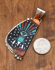 Larger intricate inlay pendant by Ray Jack, Navajo.