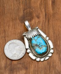 Smaller dead-pawn Navajo pendant with Kingman, Arizona turquoise.