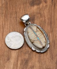 Navajo Sterling pendant with ribbon/boulder turquoise by Alfred Martinez