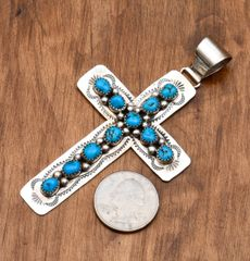 Navajo Sterling cross with 11 Sleeping beauty turquoise stones.