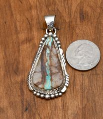 Navajo Sterling pendant with boulder/ribbon turquoise by Elousie Kee