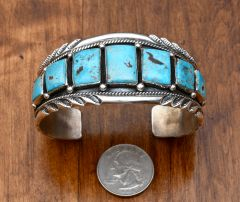 Dead-pawn Navajo Sterling cuff with seven square and rectangular Kingman turquoise stones by Jason Bahe
