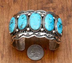 Wide Navajo Sterling cuff with five Kingman turquoise stones, by Marcella James.
