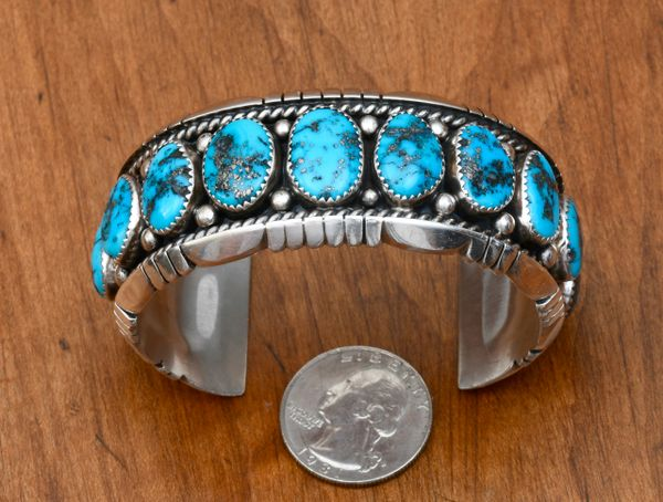 Dead-pawn Navajo Sterling row cuff with 13 Morenci turquoise stones by Jefferson James.