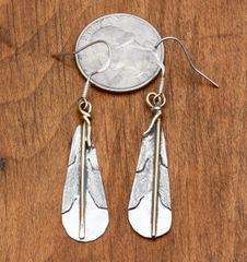 Dead-pawn Navajo Sterling feather earrings with gold-fill.