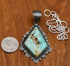 Navajo pendant with old-style silverwork and Royston turquoise by Gilbert Tom.—SOLD!