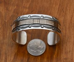Small wrist size Bruce Morgan 14kt. gold and Sterling hand-stamped cuff.