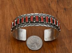 Sterling Navajo row cuff with 14 pieces of Mediterranean red coral by Tiffany Jones.