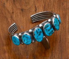 Smaller wrist size Dead-pawn Navajo cuff with six Sleeping Beauty turquoise stones.