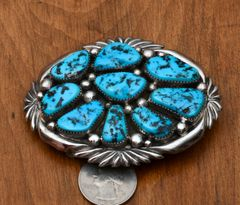 Navajo dead-pawn heavy silver belt buckle with pristine Sleeping Beauty turquoise, by Wilson Begay.
