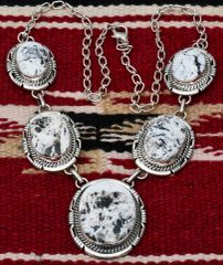 Navajo Sterling five-pendant necklace with white buffalo stones by Robert Shakey.