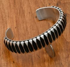 Larger wrist-size Navajo two-tone Sterling cuff by Leander Tahe.