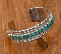 Sterling Navajo row cuff with 17 teardrop turquoise stones by Tommy Lowe.