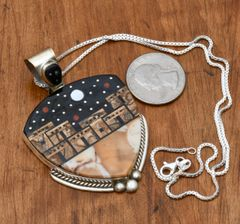 Zuni-type Sterling pendant with inlaid pueblo scene, by Michael Jack.—SOLD!