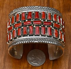 Wide Sterling Navajo cuff with 30 pieces of Mediterranean red coral.