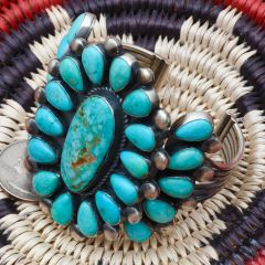 Exquisite 25-stone Navajo Sterling cluster cuff by Readda Begay.