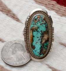 Size 9.5 Sterling Navajo ring with Royston turquoise, by Michael Jack.
