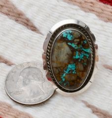 Size 8.5 Navajo Sterling ring with ribbon (boulder) turquoise, by Augustine Largo.