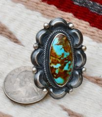 Size 8.25 Sterling Navajo Ring with Kingman, Arizona turquoise, by Juanita Long.