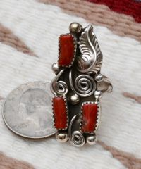 Size 6.5 Sterling Navajo ring with three pieces of Mediterranean branch coral.