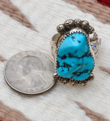 Size 9.25 dead-pawn Navajo Sterling ring with Sleeping Beauty turquoise.