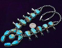 Slightly smaller size Navajo Sterling squash blossom necklace with Kingman, Arizona turquoise, by Augustine Largo.—SOLD!