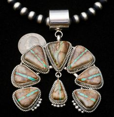 "Eight-stone Sterling Navajo ""naja"" with ribbon (boulder) turquoise by Mary Ann Spencer, and a 24-inch, 8mm silver beaded necklace (known as ""Navajo ""pearls"").—SOLD!"