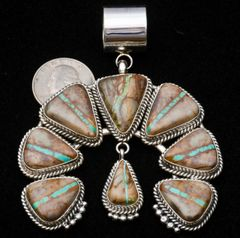 Eight-stone Sterling Navajo naja with boulder (ribbon) turquoise, by Mary Ann Spencer.—SOLD!