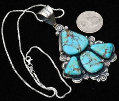 Stunning four-stone Navajo Sterling pendant with Kingman turquoise, by Juanita Long.
