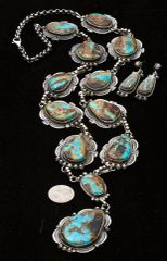14-stone (including the earrings) Navajo lariat-style pendant necklace set with boulder (ribbon) turquoise, Gilbert Tom.