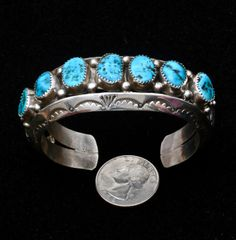 Small wrist-size dead-pawn Navajo heavy-silver row cuff with Sleeping Beauty turquoise.