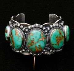 Heavy-silver Navajo cuff with five Royston, Nevada turquoise stones, by Gilbert Tom.—SOLD!