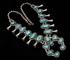 Vintage Navajo Sterling squash-blossom necklace with 20 pristine turquoise stones.