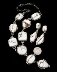 Navajo Sterling nine-pendant necklace and exquisite matching earrings made with choice white buffalo stones.