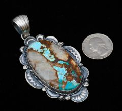 Large Sterling Navajo pendant with ribbon (boulder) turquoise by Gilbert Tom.