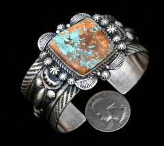 Extensively hand-stamped Navajo Sterling cuff with single boulder turquoise stone, by Robert Shakey.—SOLD!