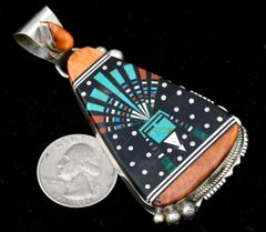 Large pendant with mosaic inlay containing spiney oyster, turquoise and black onyx, by Ray Jack.