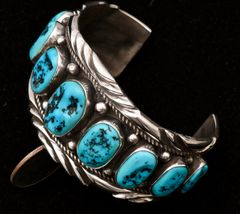 Dead-pawn Navajo Sterling row cuff with nine pristine Sleeping Beauty turquoise stones.