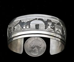 Sterling Navajo storyteller cuff by Tillie Jon.