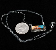 "Smaller-size Navajo Sterling 19-inch ""bar"" necklace made of compressed turquoise, spiney-oyster shell and bronze, by Augustine Largo."
