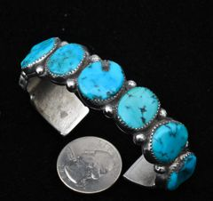 Smaller size dead-pawn Navajo Sterling row cuff with seven Sleeping Beauty turquoise stones.—SOLD!