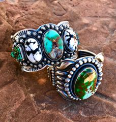 Navajo Sterling cuff with extensive repousse' stamping; premium Royston turquoise and 6.5-inch wrist circumference (bottom cuff in pic).