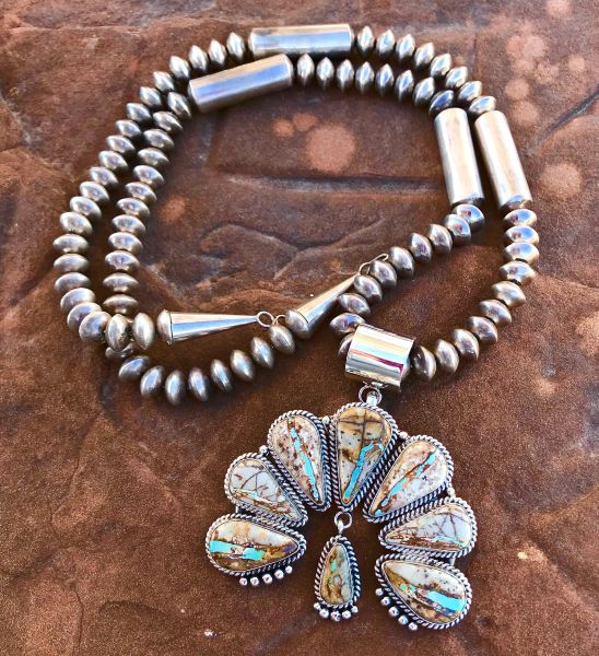 Navajo Sterling eight-stone Naja with ribbon/boulder turquoise paired with dead-pawn 32-inch barrel-bead Navajo pearls (each can be purchased separately).